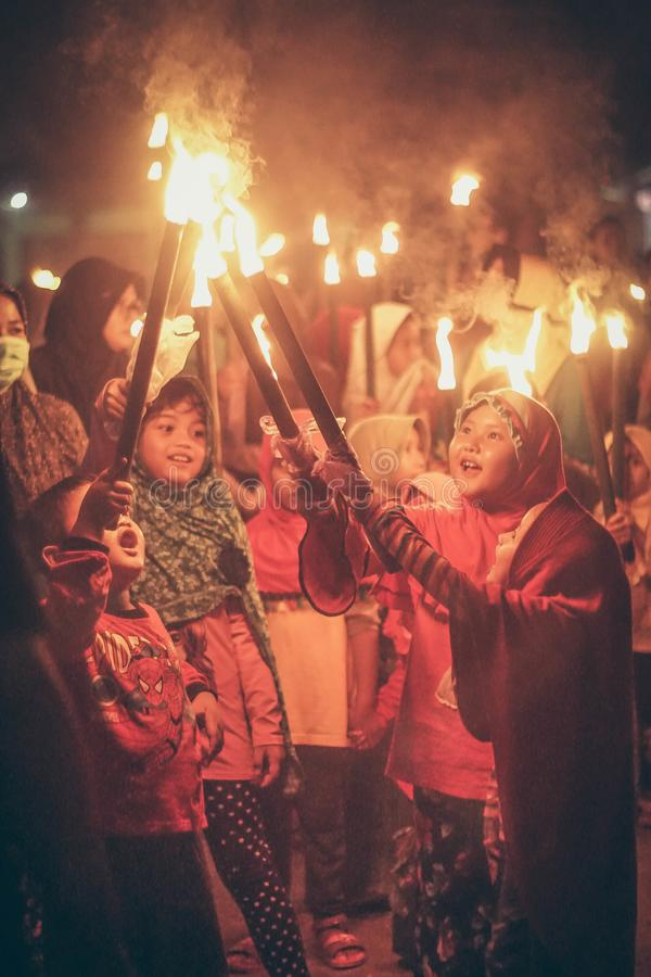 Central Java, Indonesia, June 12th 2018 : Muslim children carry torches as they take part during a parade islamic new year stock photography