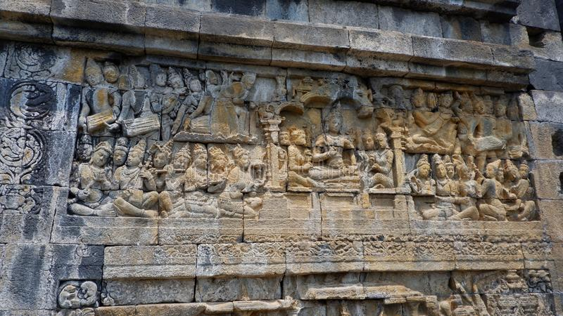 Central Java, Indonesia - 27/Sep/2019. Detail of relief Borobudur Temple / Candi Borobudur. Borobudur is the largest Buddist templ. E or temple in the world royalty free stock image
