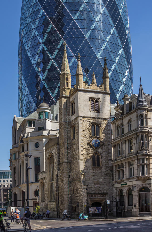 CENTRAL LONDON / ENGLAND - 18.05.2014 - The Gherkin sky-scraper is seen behind the St. Andrew Undercroft medieval church in London. Detailed view of the Gherkin stock images