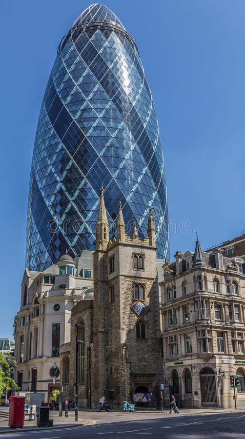 CENTRAL LONDON / ENGLAND - 18.05.2014 - The Gherkin sky-scraper is seen behind the St. Andrew Undercroft medieval church in London. The Gherkin sky-scraper is stock images