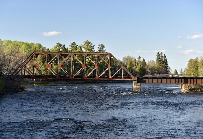 Central Maine & Quebec Railroad Bridge. This is a Spring picture of the Central Maine & Quebec Railroad Bridge Over The East Outlet Of Moose Lake located in royalty free stock photos