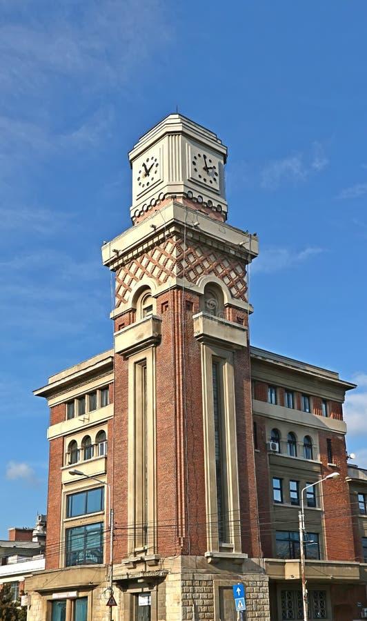 Central market building in Ploiesti, Romania. The tower with a clock of the central market building in Ploiesti, Romania royalty free stock photography