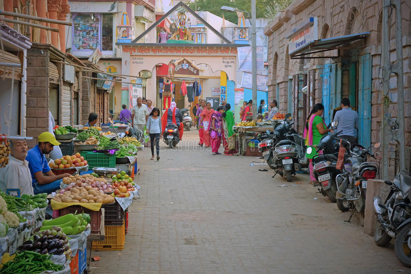 Central market place in Bhuj, India. BHUJ, INDIA - NOVEMBER 5, 2016: Fruit and vegetables for sale in the central market in the main settlement in the Gujarati royalty free stock photo