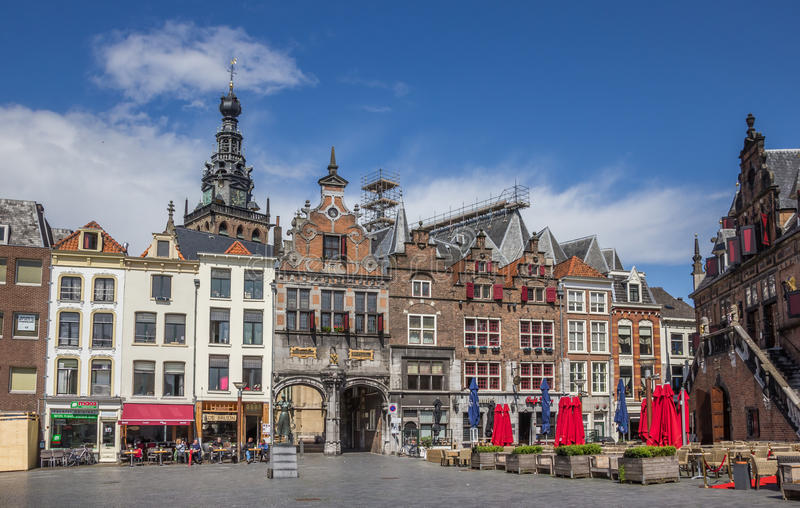 Central market square in Nijmegen. The Netherlands, with people sitting in the sun stock image