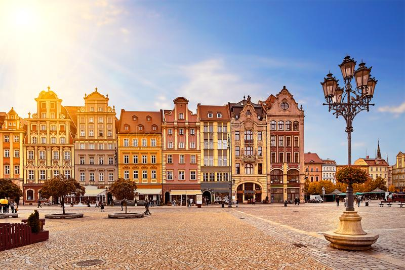 Central market square in Wroclaw Poland with old colorful houses, street lantern lamp and walking tourists people royalty free stock photography
