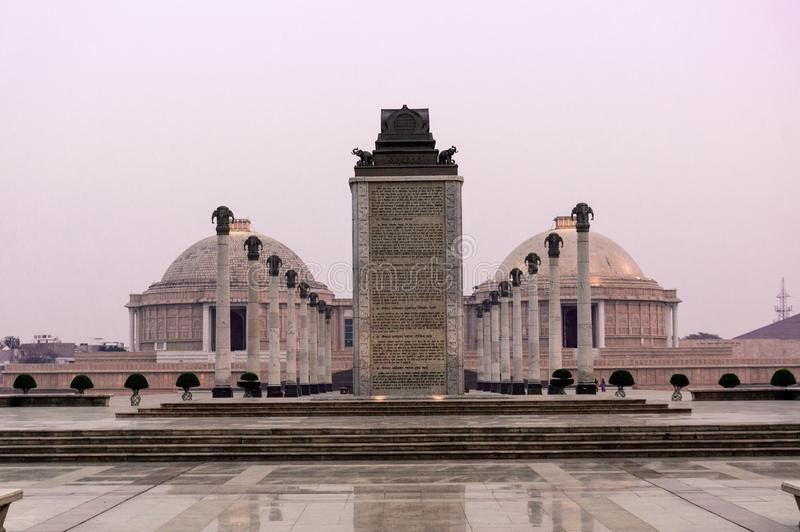 Central monument and pillars with the museum domes in Ambedkar P. Central monument with symmetrical pillars with the museum domes of the famous Ambedkar Park royalty free stock photo