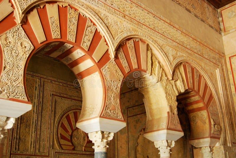 Central Nave, Medina Azahara. Arches with elaborate plasterwork in the Central nave, Hall of Abd al-Rahman III, Medina Azahara (Madinat al-Zahra), Near Cordoba stock photos