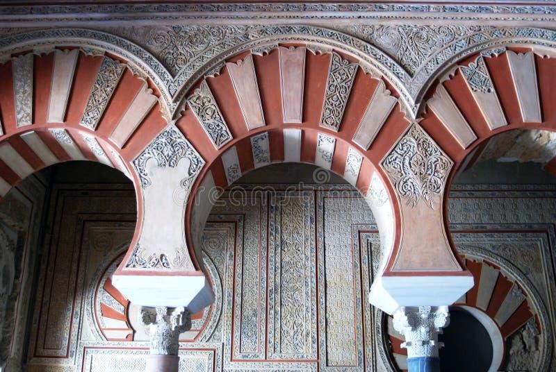 Central Nave, Medina Azahara. Arches with elaborate plasterwork in the Central nave, Hall of Abd al-Rahman III, Medina Azahara (Madinat al-Zahra), Near Cordoba royalty free stock photos
