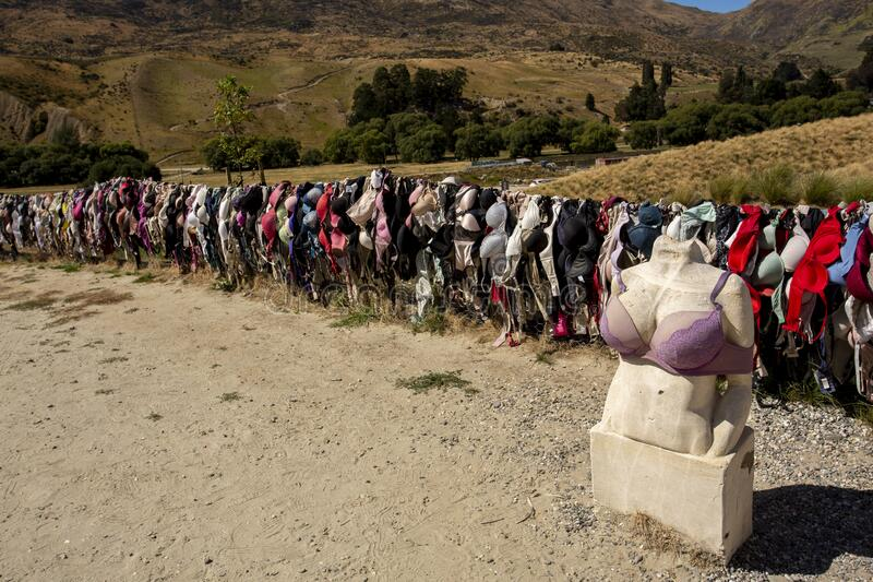 New Zealand. New Zealand breast cancer foundation. Central Otago,New Zealand - February 14,2020 : Cardrona Bra Fence gradually became a well known site as the stock photos