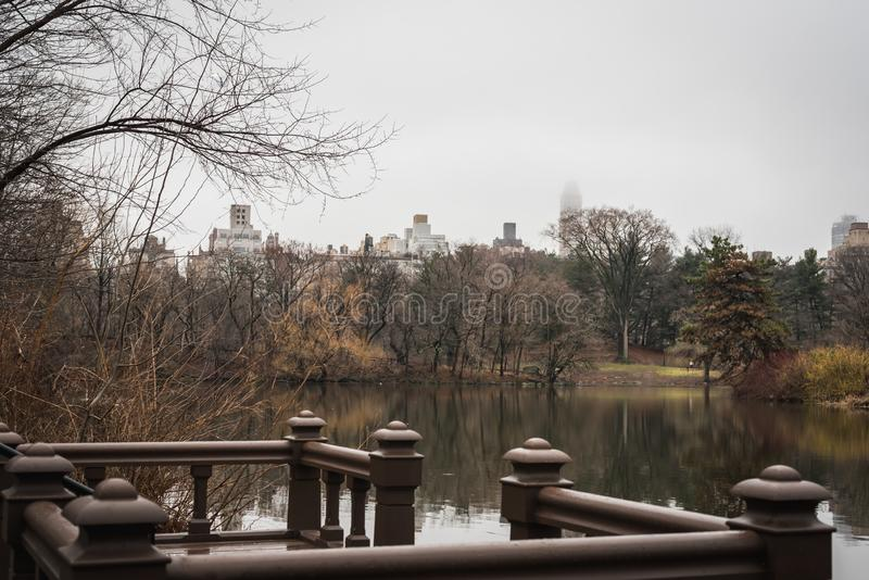 Central Park Lake under mist and New York City rain stock images