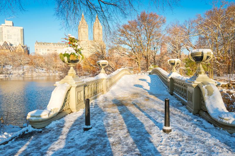 Central Park. New York. USA in winter covered with snow. Bow bridge. Central Park. New York. USA in early winter covered with snow. Bow bridge royalty free stock image