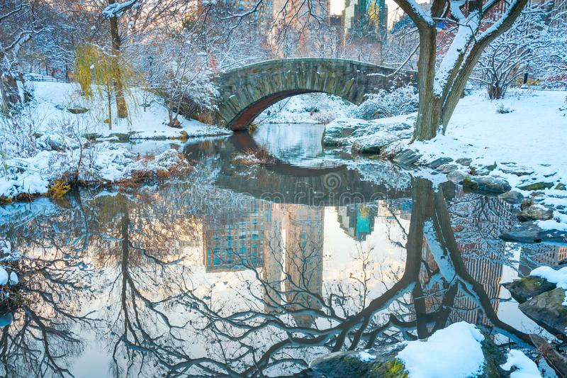 Central Park. New York. USA in winter covered with snow. Gapstow bridge. Central Park. New York. USA in winter covered with white snow. Gapstow bridge royalty free stock photos