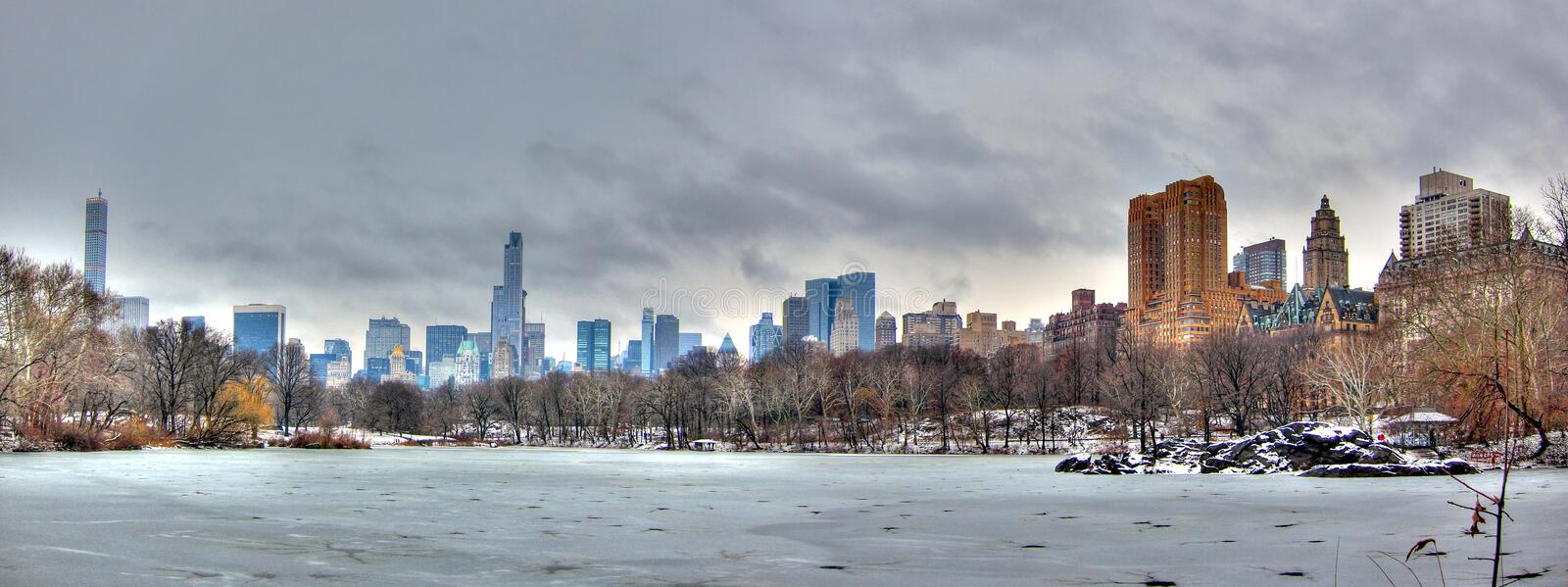 Central Park In Snow, Manhattan, New York City. A panoramic view of Manhattan from central park covered in snow, New York City royalty free stock photo