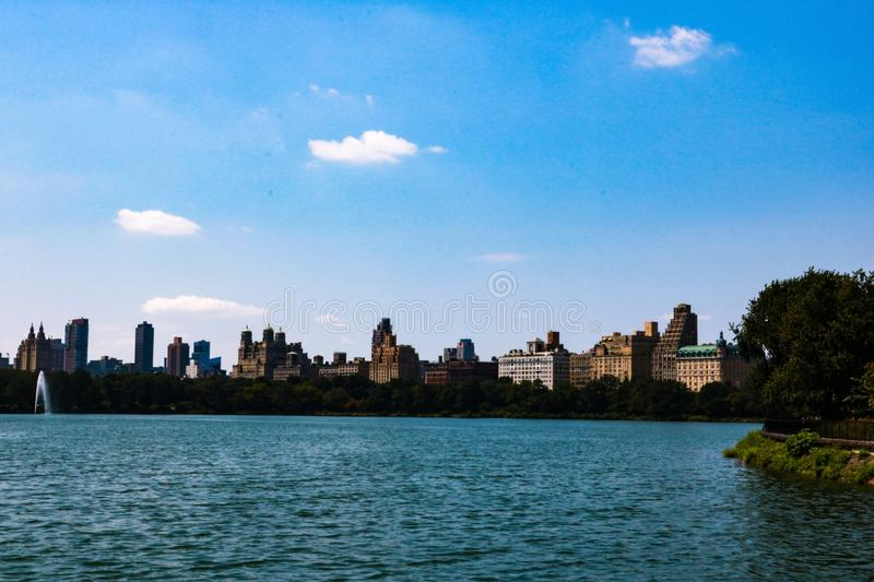 Central Park South skyline from Central Park Lake in New York City royalty free stock image