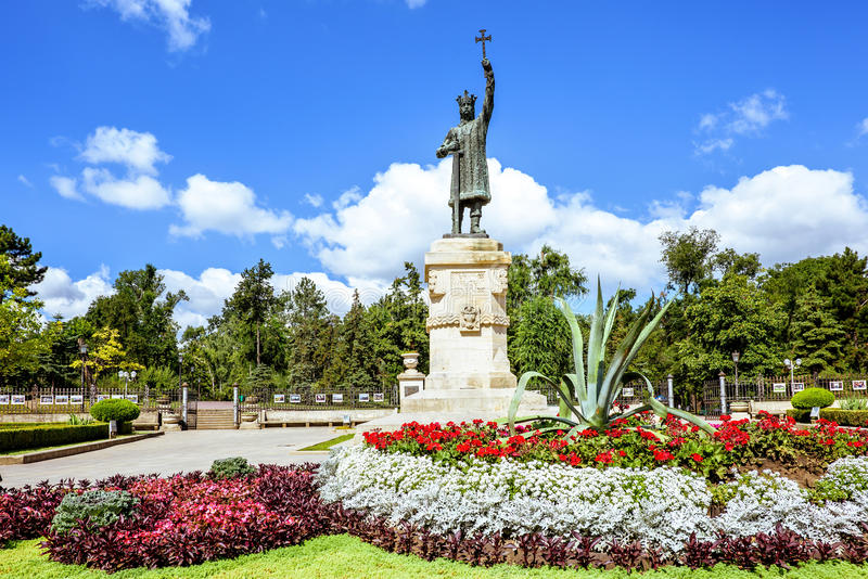 Central park with statue of stefan cel mare. Central park with statue of stefan the great, Chisinau, Moldova, sunny day blue sky trees and flowers stock photos