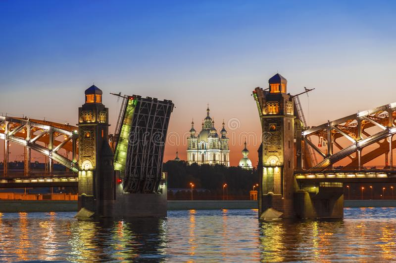 The central part of the divorced Bolsheokhtinsky bridge on the Neva river overlooking the Smolny Cathedral during the white nights. Saint Petersburg, Russia stock photos
