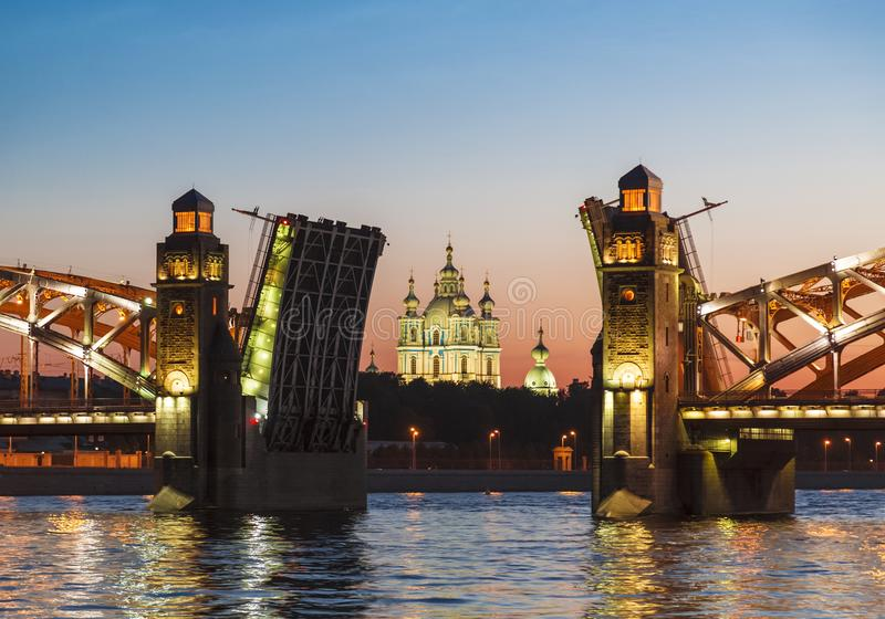 The central part of the divorced Bolsheokhtinsky bridge on the Neva river overlooking the Smolny Cathedral during the white nights. Saint Petersburg, Russia royalty free stock photography