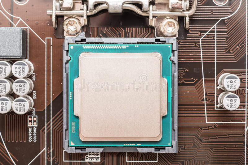Central Processing Unit (CPU) Chip. Installed On Motherboard Socket royalty free stock photos