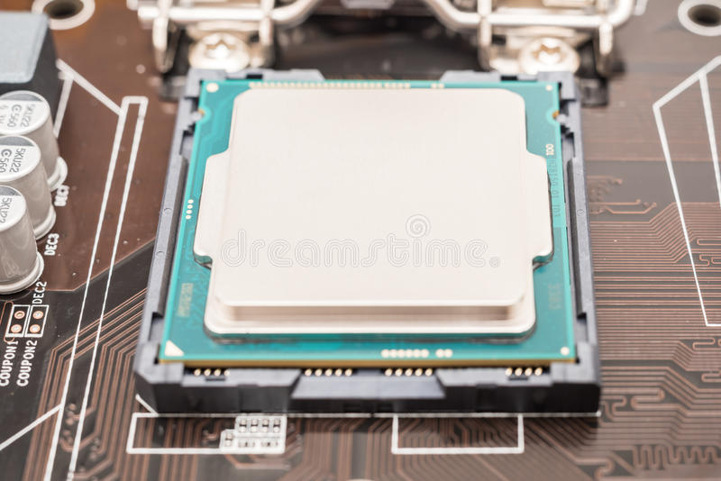 Central Processing Unit (CPU) Chip. Installed On Motherboard Socket stock image