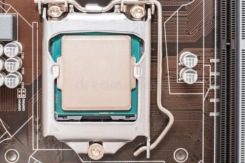 Central Processing Unit (CPU) Chip. Installed On Motherboard Socket stock photography