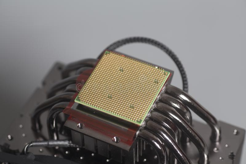 Central processing unit CPU microchip on Computer fan processor stock photos
