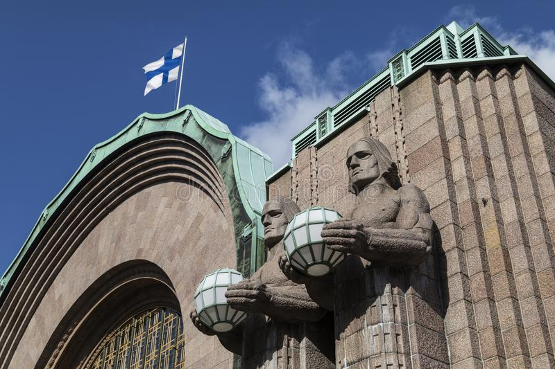 Central Railway Station - Helsinki - Finland. Helsinki - Finland. Art Deco figures at the main entrance to the central Railway Station. The station is used by stock photo