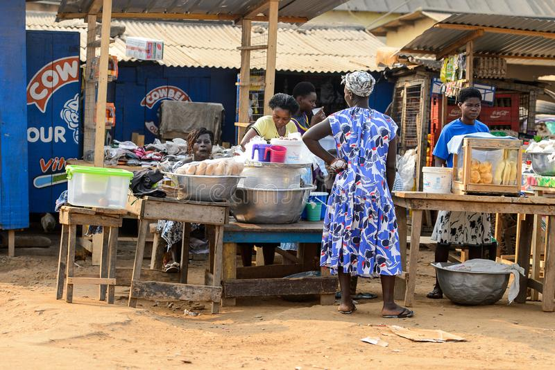 Unidentified Ghanaian people sell food on the market in local v. CENTRAL REGION, GHANA - Jan 17, 2017: Unidentified Ghanaian people sell food on the market in royalty free stock images