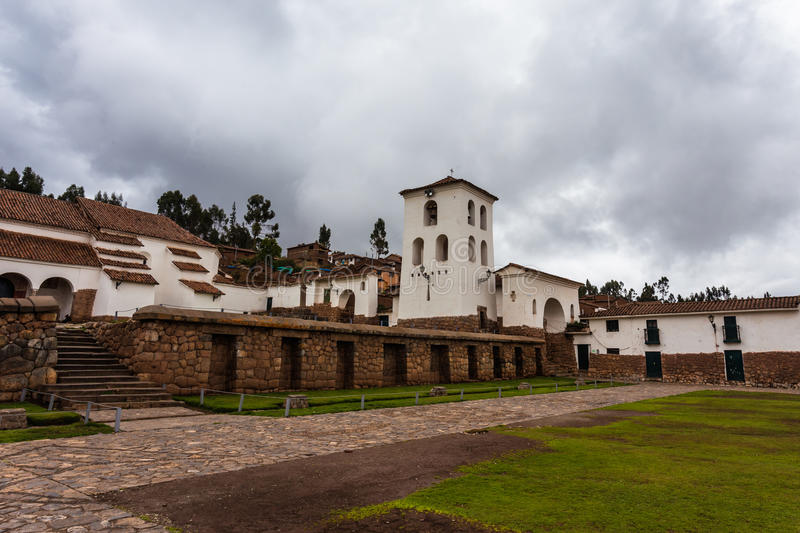 Central Square with a bell tower. In a restored town Inca in the province of Chinchero, Peru royalty free stock image