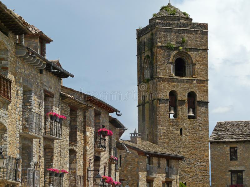Central square and church tower. Village of Aínsa. Medieval art. Spain. royalty free stock photos