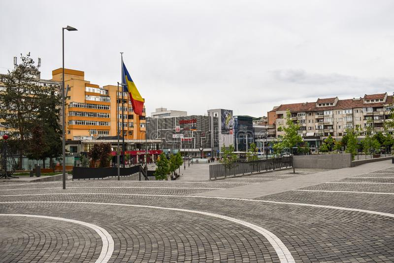 Central square with concrete pavement in the downtown of the modern city Ramnicu Valcea. Romanian travel destination. Ramnicu stock photography