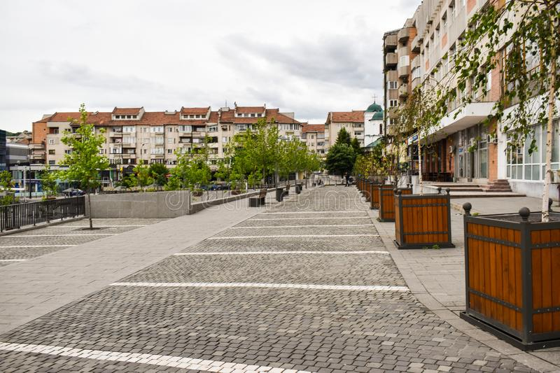 Central square with concrete pavement in the downtown of the modern city Ramnicu Valcea. Romanian travel destination. Ramnicu royalty free stock photo