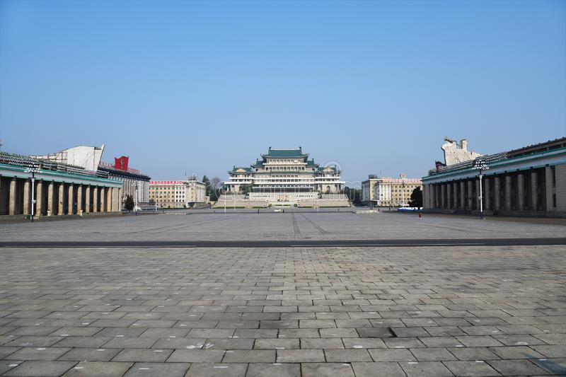 Pyongyang, North-Korea. Kim Il Sung square. The central square of Kim Il Sung at morning. Great People`s Study House with of portraits of two presidents DPRK on royalty free stock photography