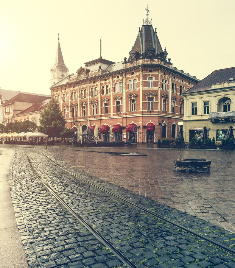 Central square in Kosice with tram rails after rain. Central square in Kosice with tram rails and paving stone after rain stock image