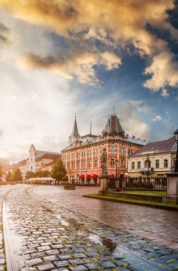 Central square in Kosice with tram rails after rain. Central square in Kosice with tram rails and paving stone after rain royalty free stock photo