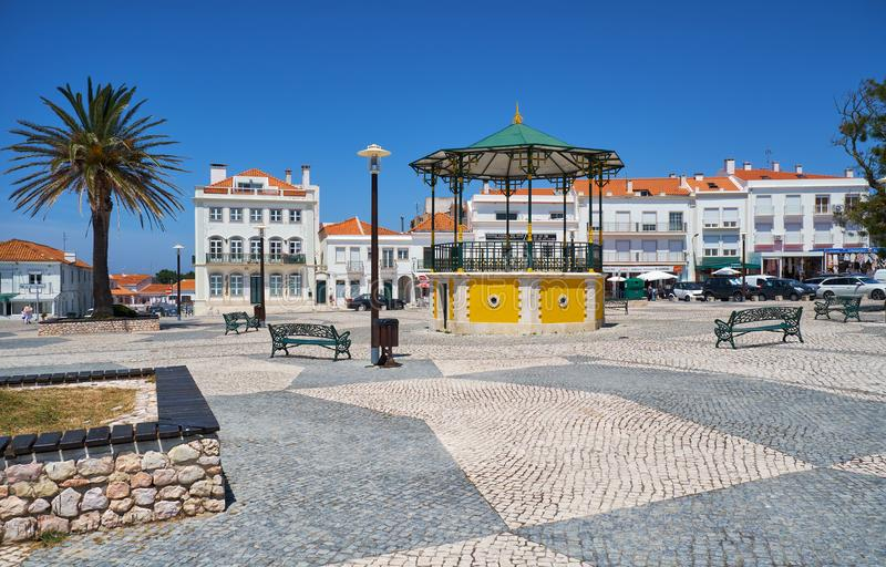 The central square of Nazare. Portugal. NAZARE, PORTUGAL - JUNE 26, 2016: The central square of Nazare with pavilion and the residential houses on the background stock photo