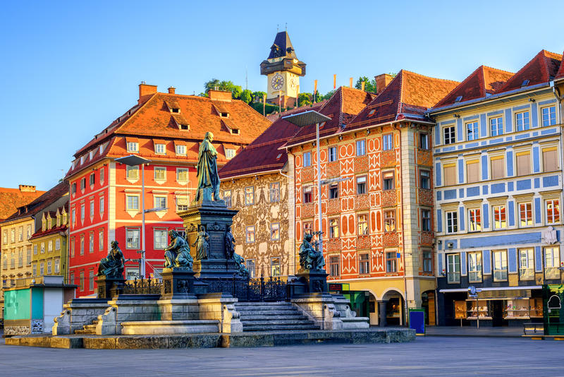 Central square in the Old Town of Graz, Austria. Painted facades and the Clocktower in the old town of Graz, Austria are on UNESCO World Cultural Heritage list stock images
