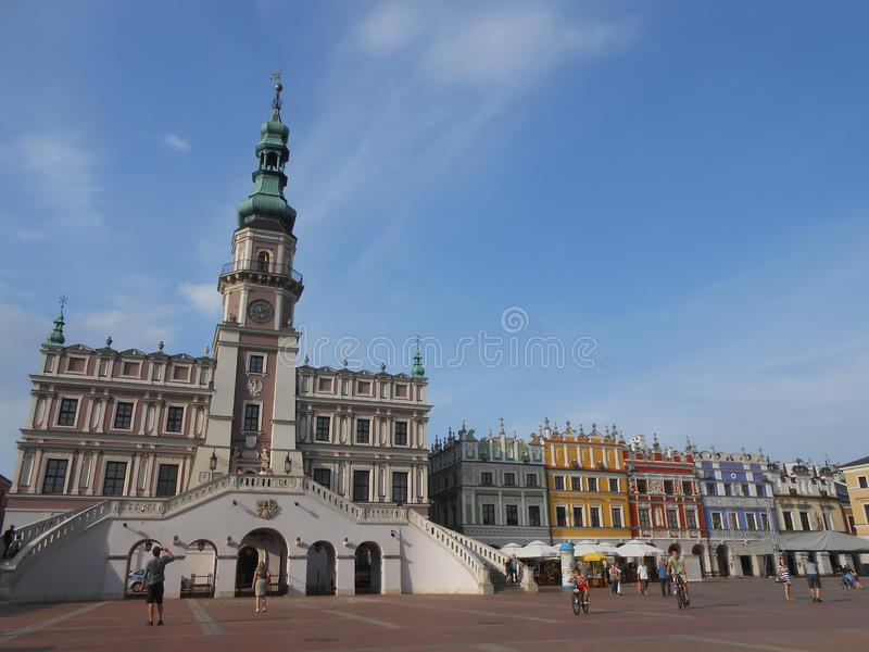 View of the central square in Zamosc, Poland. The central square with the townhall and ancient coloured buildings royalty free stock photos