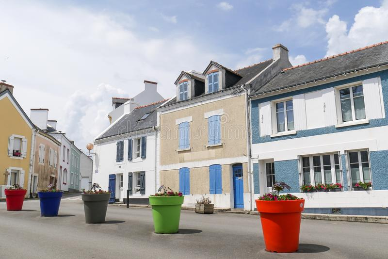 Central square of a typical brittany village with giant colored flower pots with nobody, Locmaria at Belle Ile en mer, Morbihan, stock photo