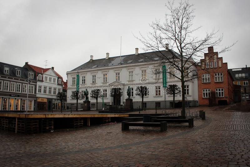 Central square in Viborg with small traditional houses, Denmark. Central square in Viborg view with small traditional houses by rainy spring, Denmark royalty free stock photography