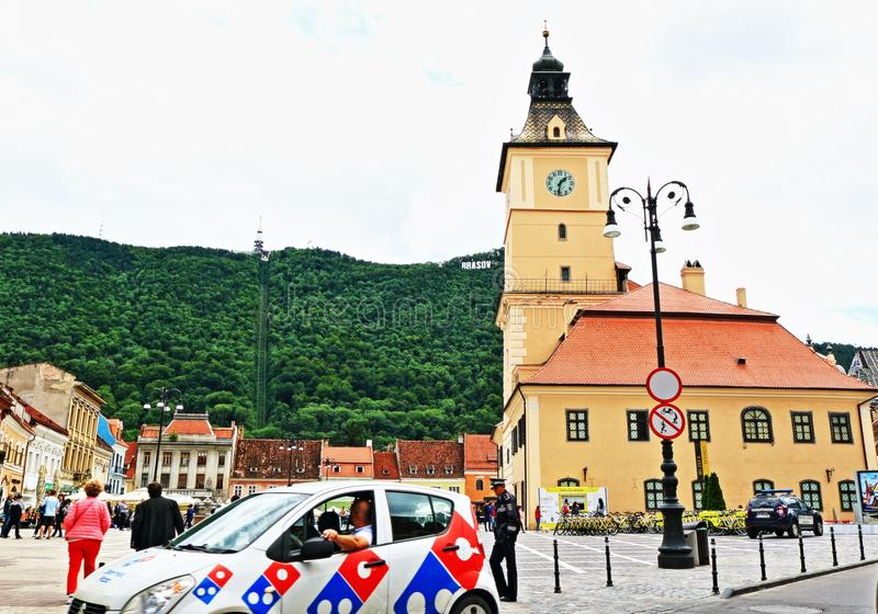 Central square view Brasov city Romania. A view of Central square with the Historical Museum Muzeul JudeÈ›ean de Istorie in Brasov city Romania.Located at the royalty free stock image