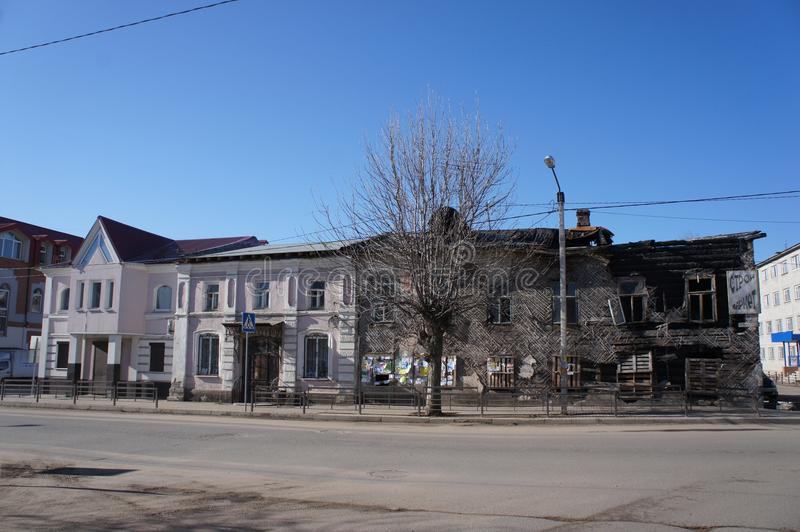 Buildings in contrast in the provincial town of Kimry, Tver region: modern and destroyed. The Central street of the provincial town of Kimry, Tver region royalty free stock images