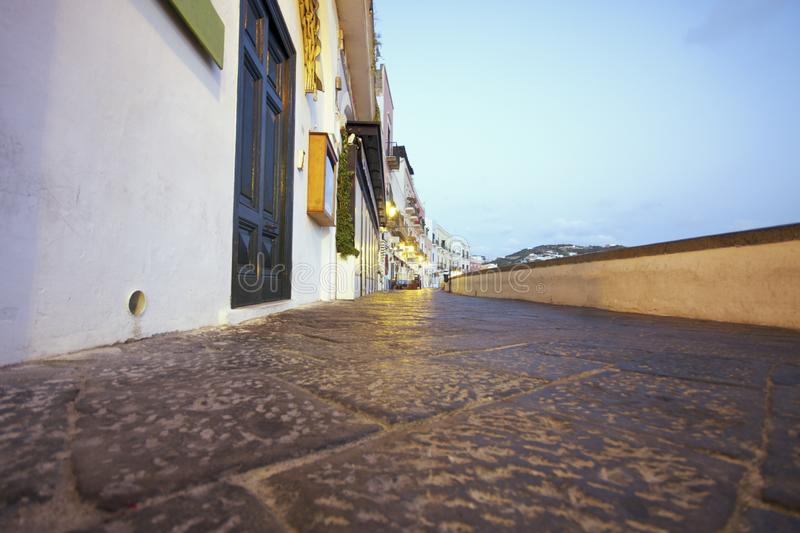 View from marble pavement on Ponza`s central street. Italy. Central street that runs along the port of the city of the island of Ponza in central Italy royalty free stock photos