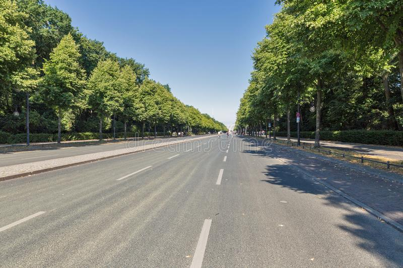 Central street in Tiergarten Park, Berlin. People walk along central street in summer Tiergarten Park, Berlin royalty free stock photos