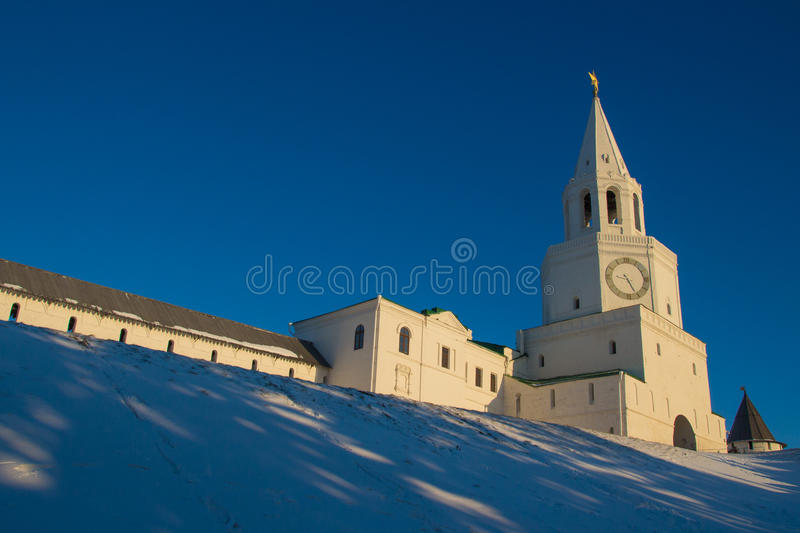 Central tower and main entrance to Kazan kremlin - Spasskaya tow. Er with big clock and belfry in early cold winter morning. View from the foot of hill royalty free stock photos