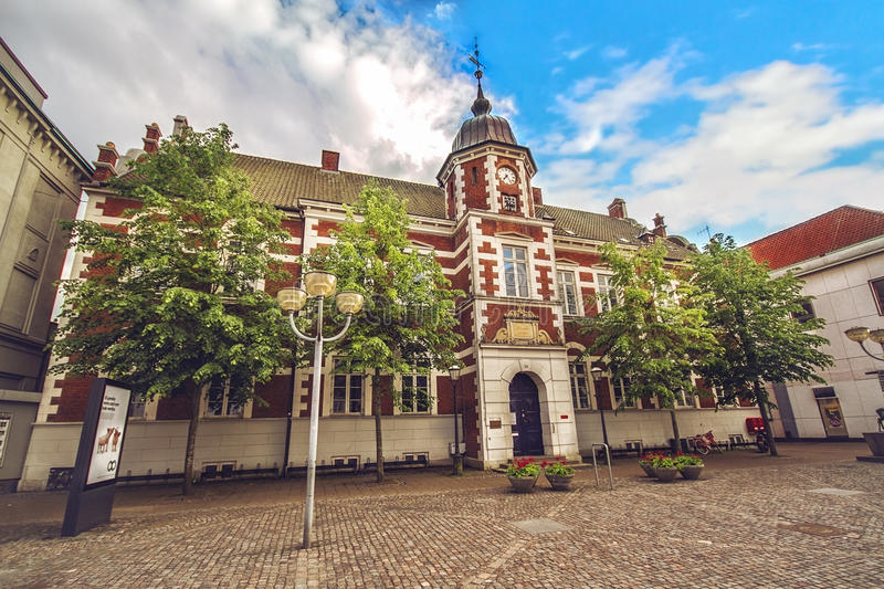 Centre of Horsens, Denmark. HORSENS, DENMARK - JUNE 11: Town Hall with the emblem of the city on the tower, in the center of Horsens, Denmark royalty free stock image