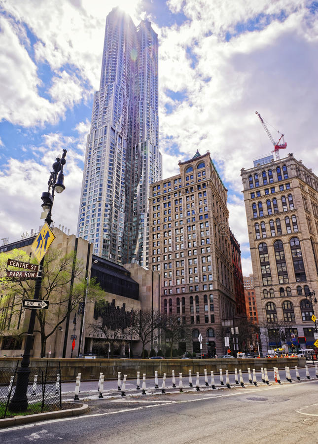 Centre Street with view on New York by Gehry Skyscraper. New York, USA - April 24, 2015: Centre Street with a view on PACE University and New York by Gehry royalty free stock images