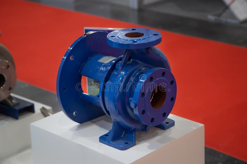 Centrifugal blue pump. Close-up of industrial centrifugal blue pump for pumping stock images