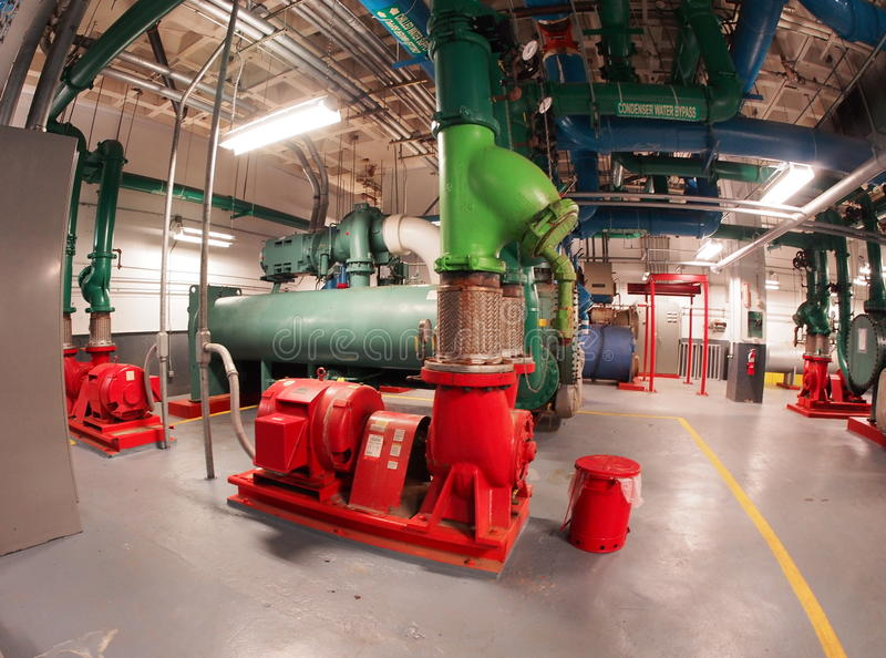 Centrifugal Chillers. And pumps for AC system in highrise building royalty free stock photos