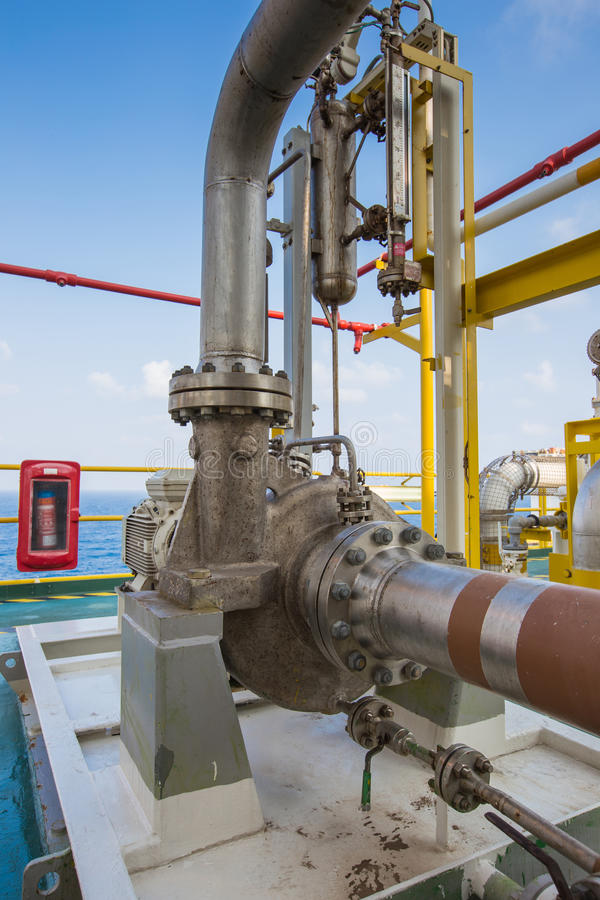 Centrifugal pump in oil and gas processing platform used for transfer liquid condensate to stabilization tower. Centrifugal pump in oil and gas processing royalty free stock image