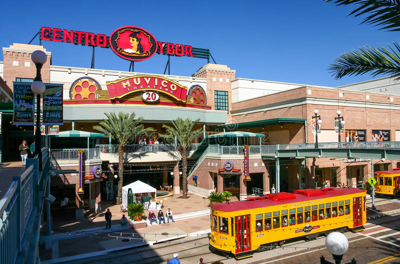 Centro Ybor entrance with yellow tram. TAMPA, FLORIDA, US - November 29, 2003: Centro Ybor entrance with yellow trams and visiting tourists, Tampa, FL royalty free stock photo